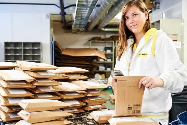 Asendia Girl smiling parcel